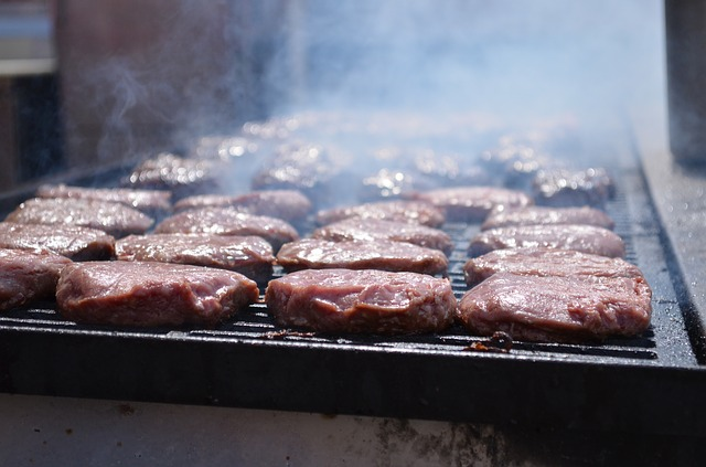 image of burgers on a grill cooking