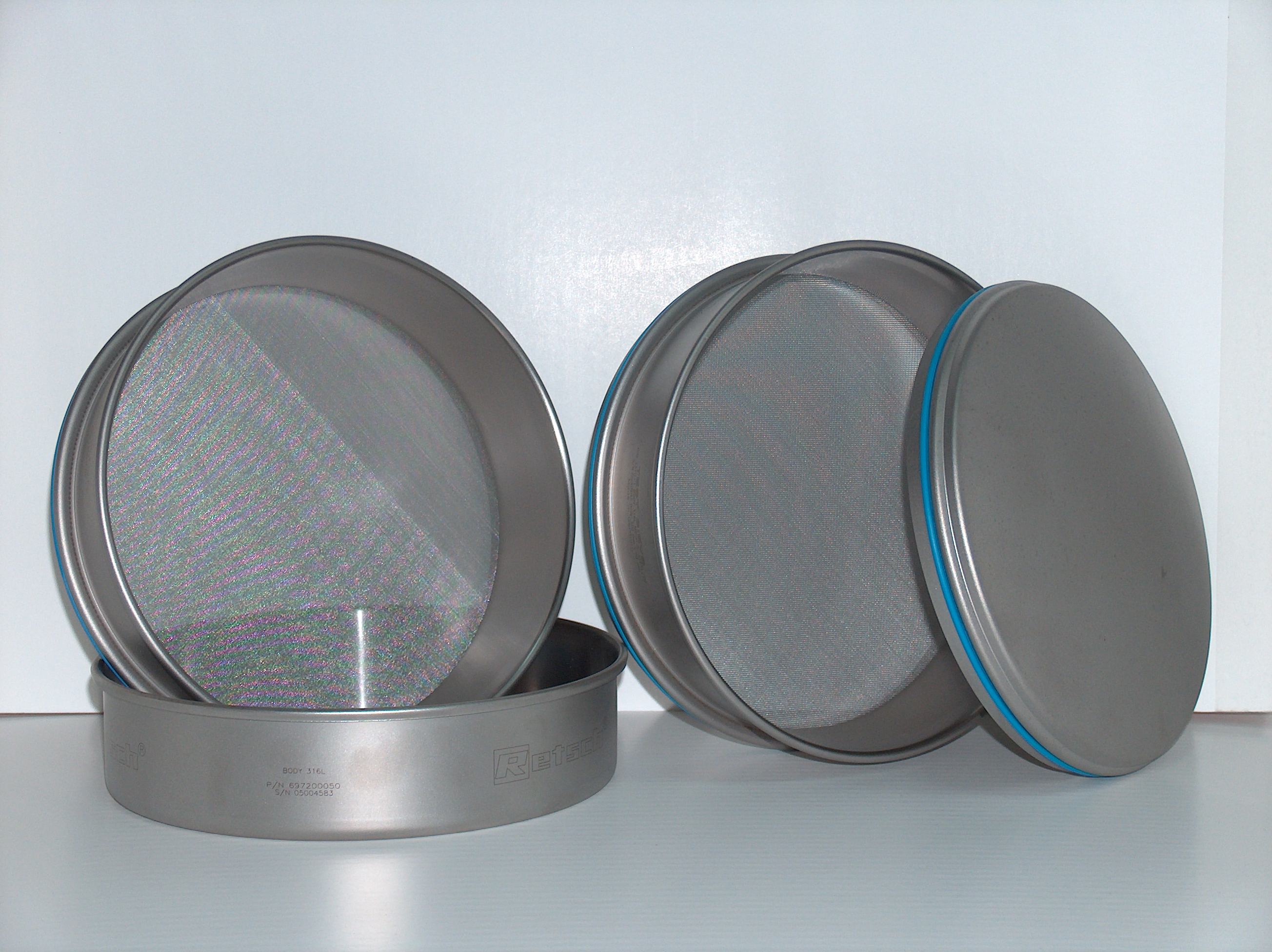 image of a tamis strainer that is shaped like a snare drum and has a mesh surface used for sifting