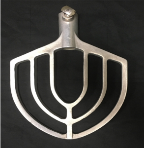 A metal fan-shaped accessory for a mixer