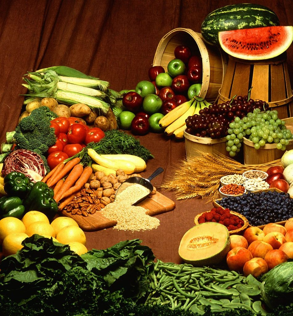 An assortment of vegetables and fruits on a table
