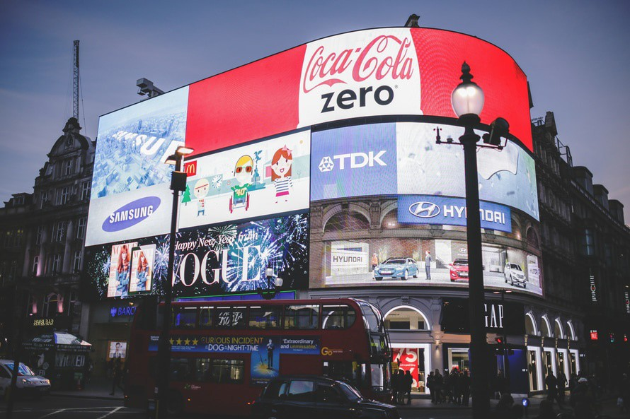 Picadilly Circus. A corner building with bright LCD billboard covering the street facing side