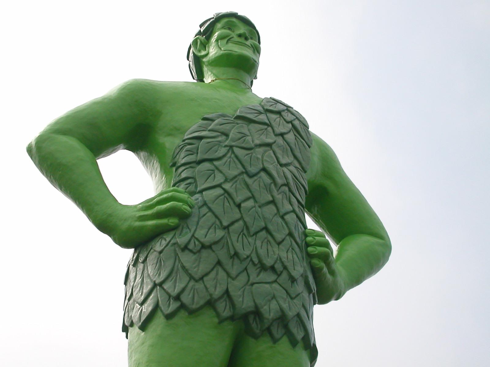A green giant wearing a leaf one shoulder shirt
