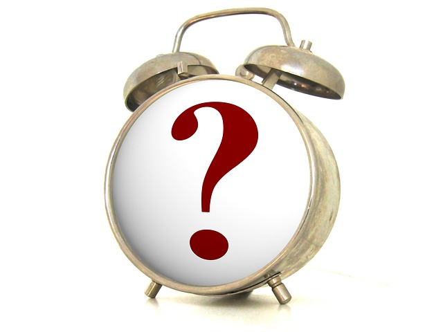 An alarm clock with a question mark on it