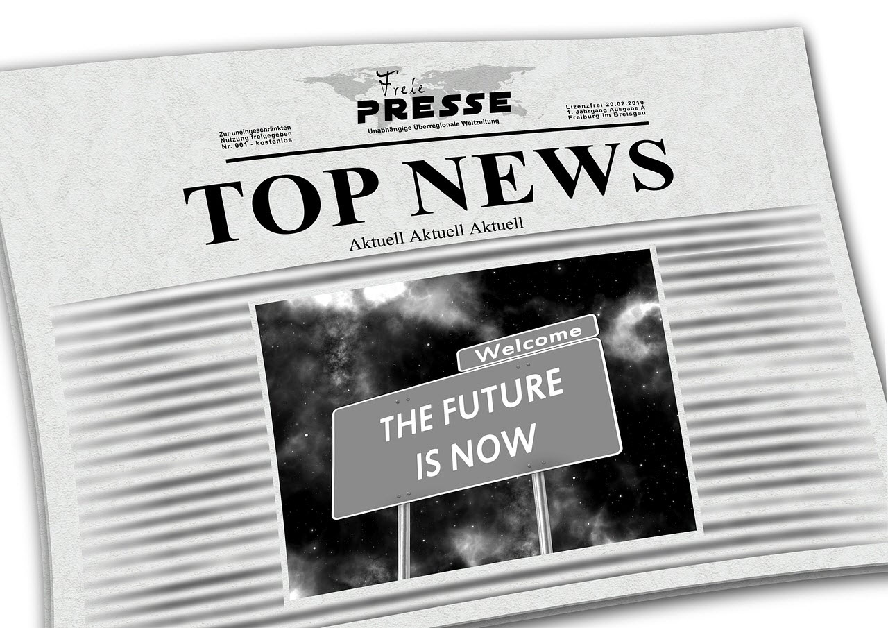 A newspaper reading Top News and an image with a sign The future is now