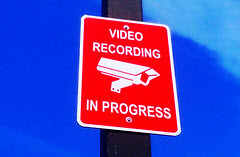 A sign that says: video recording in progress