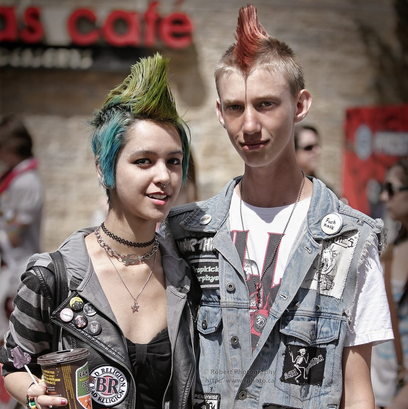 Two teens with colorful Mohawk hairstyles and punk rock clothes