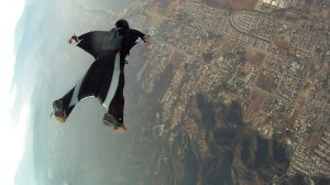 A person falling in a wingsuit, which works to reduce the vertical velocity of a skydiver's fall.