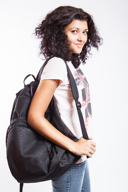 A college student wearing a backpack