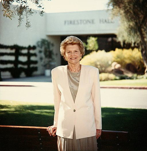Betty Ford poses for her picture in front of firestone hall